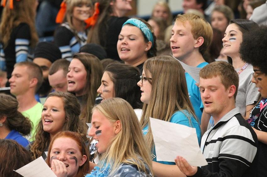 Seniors sing the school song during the fall homecoming pep session.