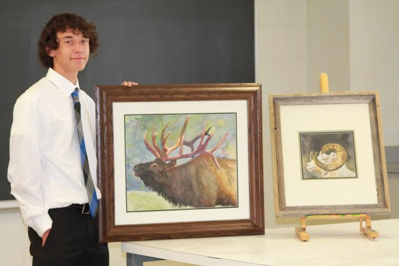 CHS junior Noah Fisher displays two pieces of his art.  Noah was awarded grand champion honors at the Indiana State Fair over the summer.