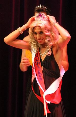 Mr. Cascade winner Gabe Gomez adjusts his tiara amid applause.