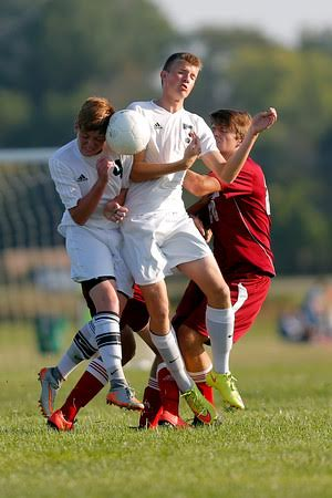 Cascade High School junior Chase Spencer (4) collides with  Cascade High School sophomore Zach Deurloo (7) as he goes for the header during the match between Danville and Cascade  at  Cascade High School in Clayton,IN. (Jeff Brown/Flyer Photo)