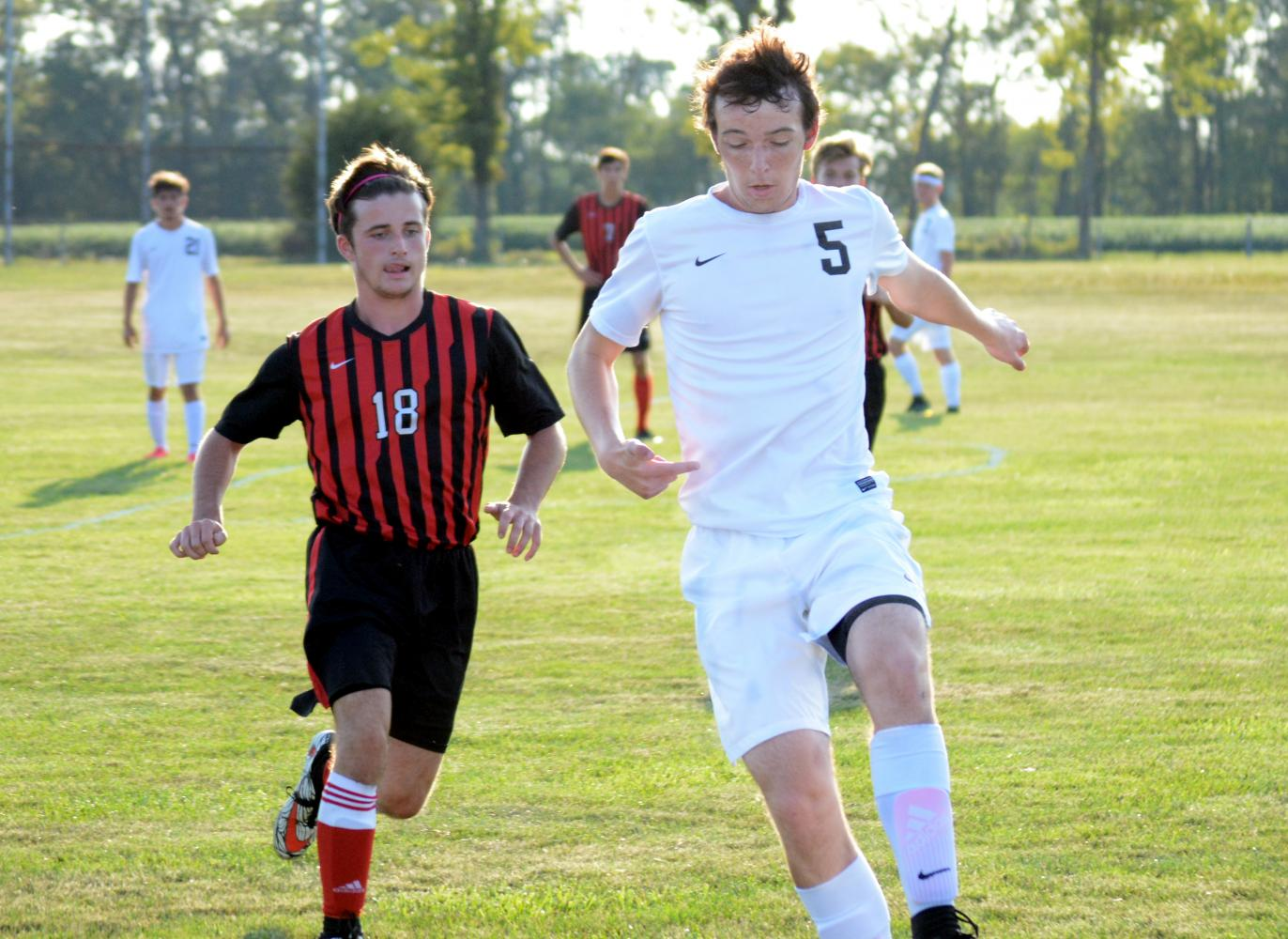 Junior Luke Pierce tackles the ball against Edgewood in a victory.