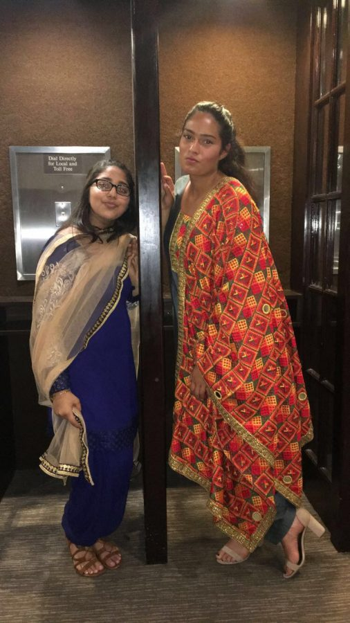 Varinder Kaur (left) and Simran Singh (right) wearing their traditional dresses
