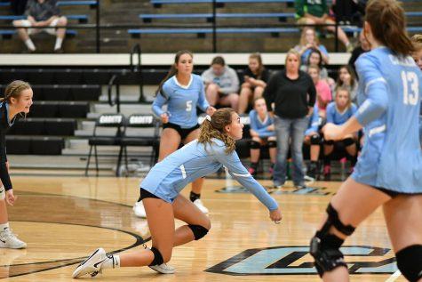 Sophomore Josie Jones digs against Cloverdale.