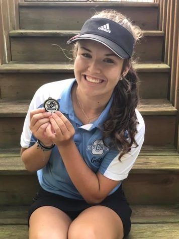 Third-year golfer, junior Addy Stevens with her Indiana Crossroads Conference hardware.