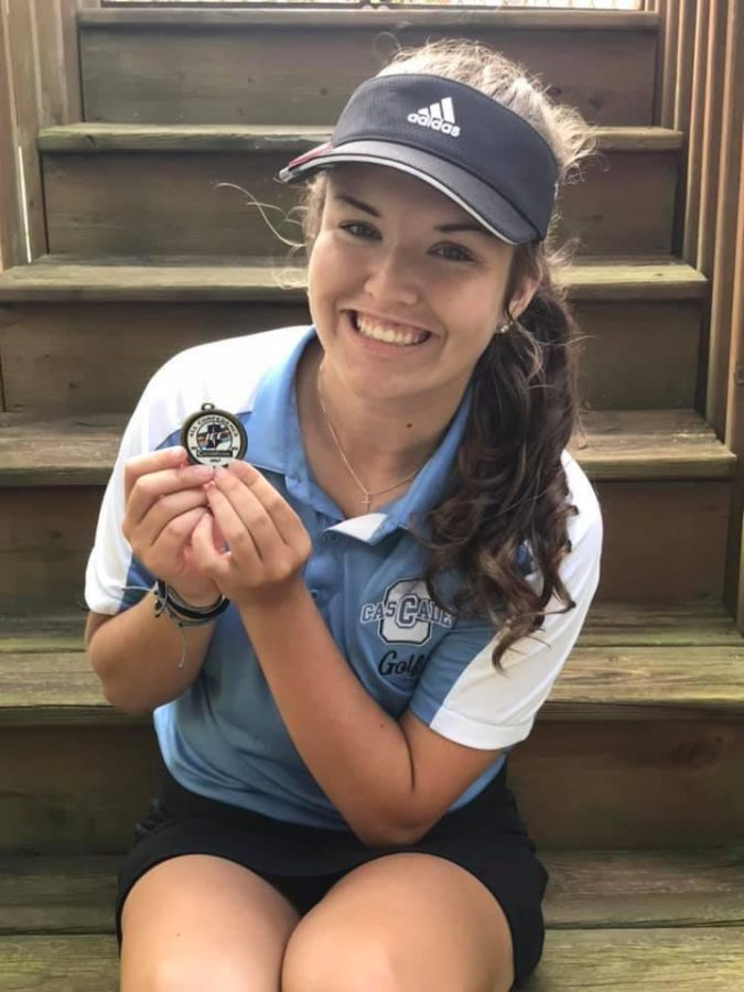 Third-year+golfer%2C+junior+Addy+Stevens+with+her+Indiana+Crossroads+Conference+hardware.